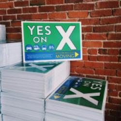 Pick up a Measure X Lawn Sign